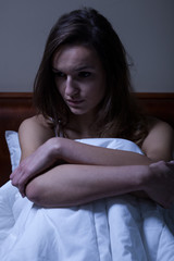 Woman sitting in the bed