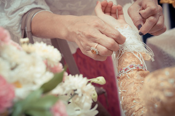 The bride's hands are tied with thread , Culture Thai Wedding