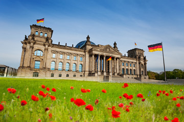 Reichstag view with red tulips and German flags