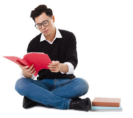 young man sitting  and reading a book