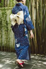 Woman in kimono and geta shoes
