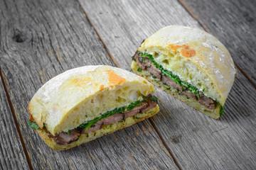 Beef Steak Sandwich on Rustic Background