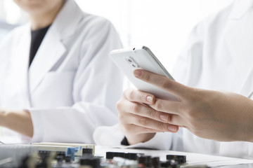 Electronic components, mobile phones, lab coats