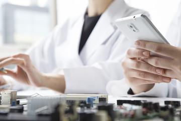 Electronic parts, cellular phones, lab coats, women
