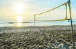 sunrise on the beach and volleyball net - 74569374