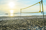 sunrise on the beach and volleyball net