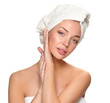 Portrait of beautiful girl touching her face with a towel on