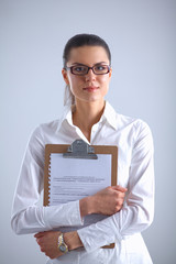 Portrait of young  business woman with folder, isolated over