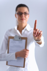 Woman touching an imaginary screen with her finger , holding a