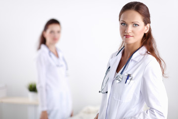 Two young woman doctor , standing in hospital