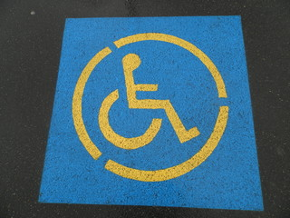 sign in the parking lot for people with disabilities