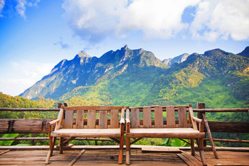 Bamboo wood chair with the background of mountain in Thailand