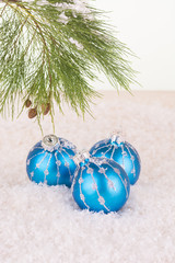 Blue Christmas baubles and pine tree branch