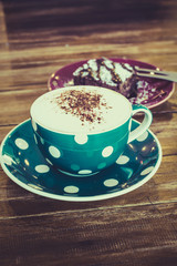 Hot Cappuccino coffee and brownie cake with vintage filter