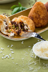 fried rice croquettes on brown plate with cheese and fork