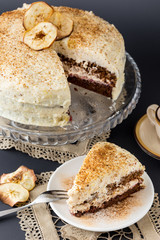 layered chocolate and cream cake with apples