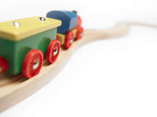 Colorful wooden toy train detail isolated on white