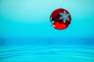 new year tree decoration flowing in the blue water