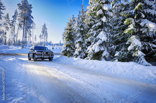 suv, car driving in rough snowy conditions - 74572976