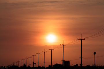 The Sun and the electrical poles.