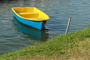 Colorful Paddle Boat on Water