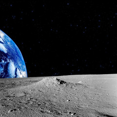 Earth-rise behind the Moons horizon.