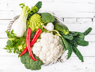 Fresh vegetables on white wood rustic background