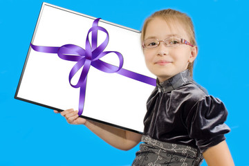 The girl shows a plastic board in festive packing