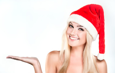 Christmas smiling  Woman. Beauty Model Girl in Santa Hat