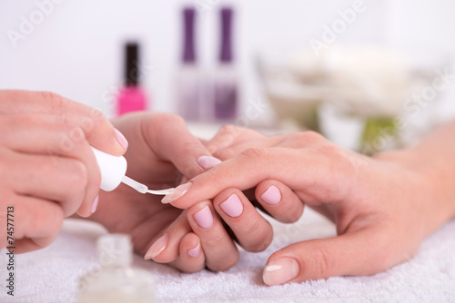 Poster, Tablou client and manicurist in manicure salon