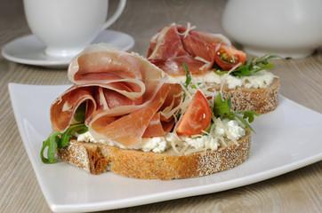 Sandwich of jamon with ricotta, arugula and cheese