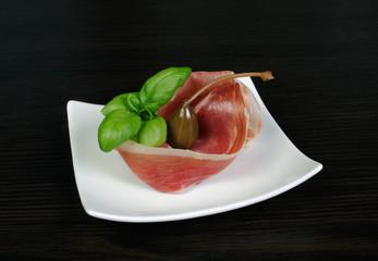 Uncooked jerked pork ham slices of jamon