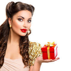 Beauty girl with gift box in her hand. Retro woman portrait