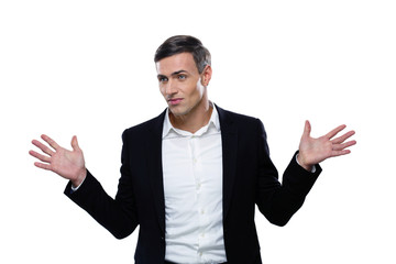 Pensivee businessman standing with hands on the sides