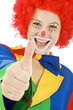 Clown in Kostüm Daumen rauf