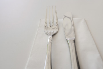Close-up of cutlery and napkin on table