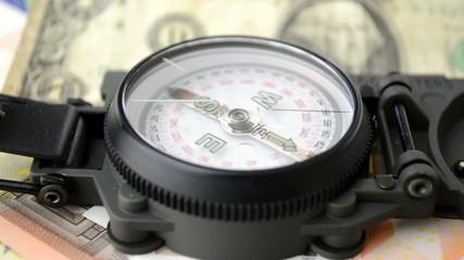close up of dollar money & compass