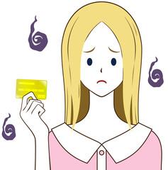 ゴールドカードを持つ女性 困り顔