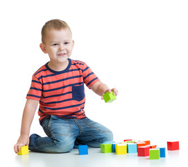Kid building tower with colorful blocks isolated