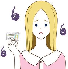 運転免許証を持つ女性 ゴールド 困り顔