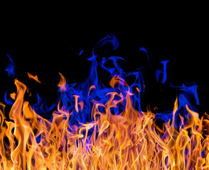 yellow and blue fire isolated on black