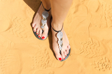 feet of women in the sand