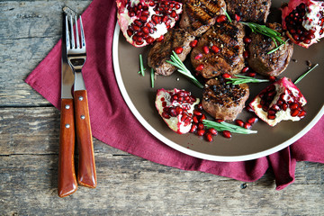 Grilled beef steak with pomegranate and spices