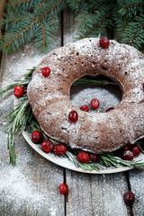 Christmas chocolate cake on a wooden background