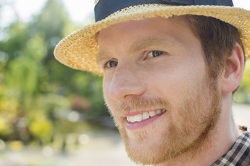 Close-up of gardener smiling while looking away