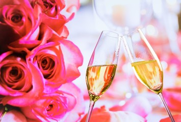 champagne flutes on wedding roses flowers background