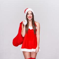 Sexy santa woman holding sack