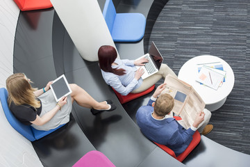High angle view of business people sitting in office lobby