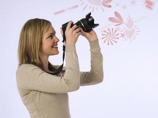 Female Photographer With Camera In Studio