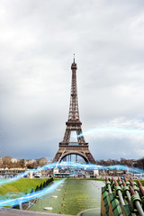 Blue streak of lights against Eiffel Tower